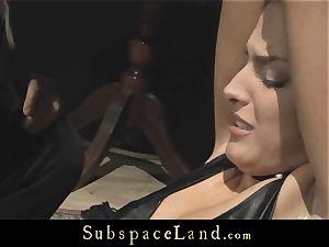 sandy-haired Lyen Parker struggles in bondage to escape