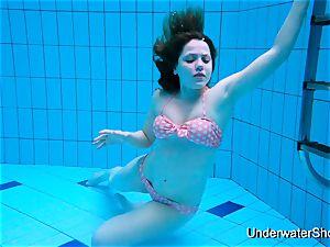 luxurious dame displays splendid bod underwater