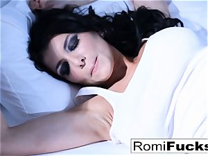 Solo fun on the bed with the big-boobed pornstar Romi Rain