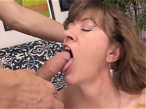 Mature babe Morgan works a knob