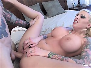 Vyxen Steel lets him jizm on her thick tits