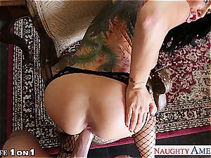 Alluring Romi Rain gets her bald cooter pummeled