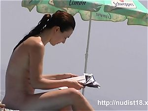 Real beach nudist is spreading on the sand