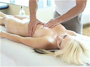 Darcie Belle takes a fountain after a rubdown