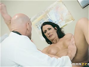 Mature Reagan Foxx gets banged while her husband waits in the colon