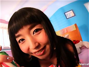 asian starlet Marica Hase plays with candy sausage
