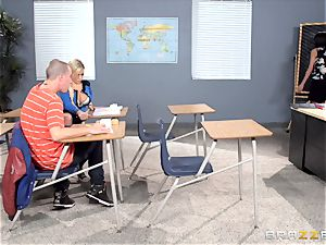 Bibi Noel and Anissa Kate plow in the classroom