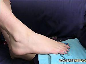 Alana Rains jerks A black lollipop With Her feet