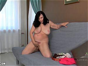 Nina frigs her immense furry twat