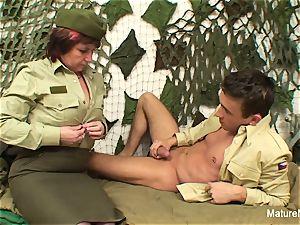 Mature officer screws her fresh recruit