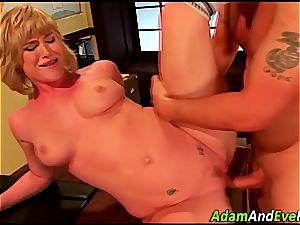 platinum-blonde Naomi rides and swallows