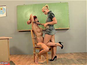 Kathia Nobili giving a mischievous lesson to a steamy crimson head
