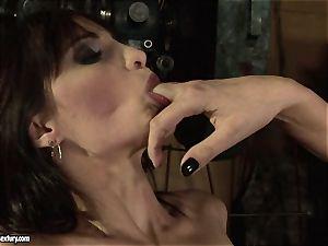 Mandy Bright frigging a warm woman in a machine shop